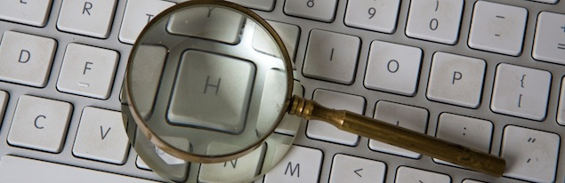 laptop with magnifying glass