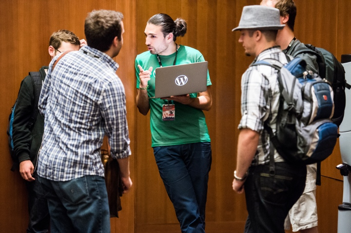 Meta engineer Nikolay Bachiyski, from Sofia, Bulgaria, chatting with others. (Image by Sheri Bigelow.)