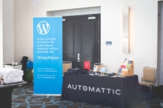The WordPress.com booth. Image by Jen Hooks