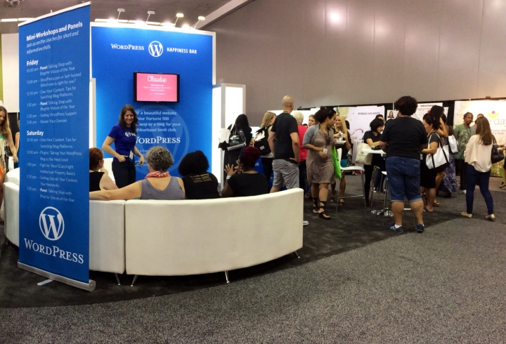 The WordPress.com booth hums with activity at BlogHer '14.