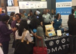 people gathered around the Automattic table at the career fair