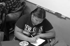 Student brainstorming on goal of her website