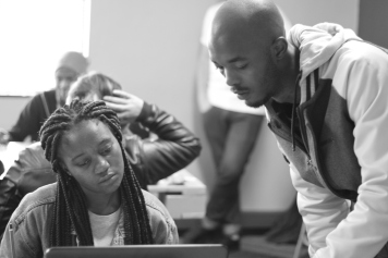 Facilitator Cyril assisting a student